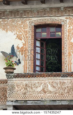 Window of historic house in Porto Ceresio (Varese Lombardy Italy) along the Lake of Lugano (Ceresio)