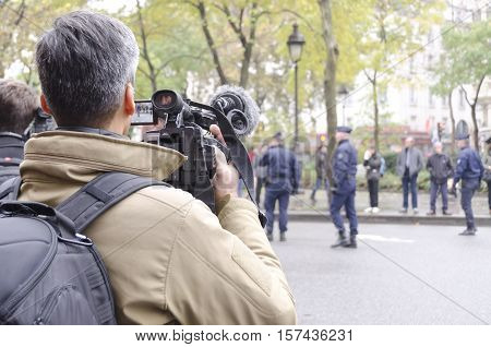 Paris France - November 13 2016: Journalist filming the police around the Bataclan during the tribute ceremony