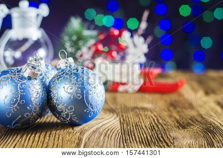The template for Christmas greetings card with blue christmas balls Christmas reindeer fir twigs cones and Christmas holly. Xmas baubles. Merry Christmas background. New year still life.