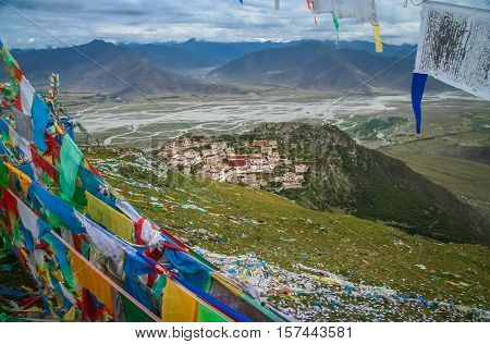 Hilltiop view of the colorful buddhist prayer flags and the Gyantse monastery near Lhasa in central Tibet.