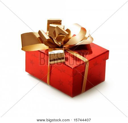 christmas gift box tied with a gold ribbon bow on white background