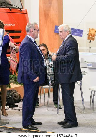 St. Petersburg, Russia - 5 October, Mature businessmen at the forum, 5 October, 2016. Petersburg Gas Forum which takes place in Expoforum.