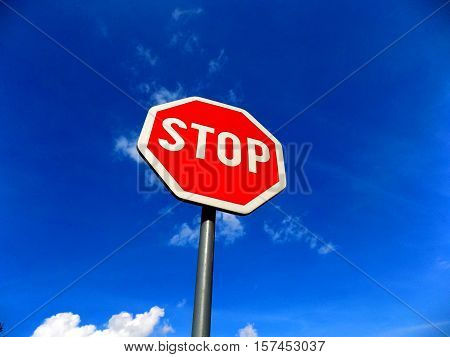 Stop roadsign and sky near highway during day