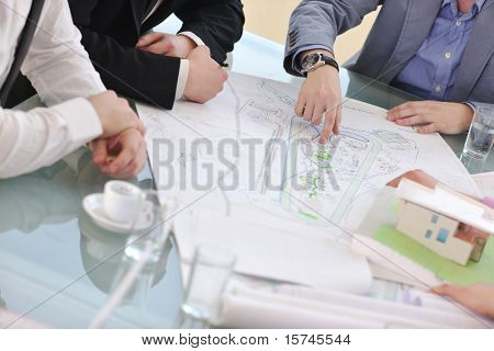 group of architect business team people on meeting looking model and desing of new real estate house