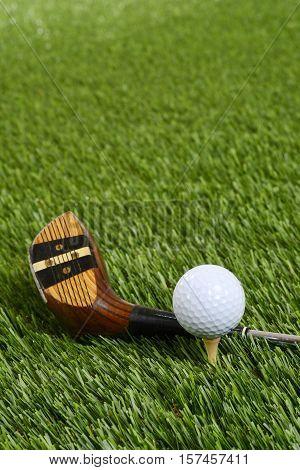 closeup golf ball with driver club on grass