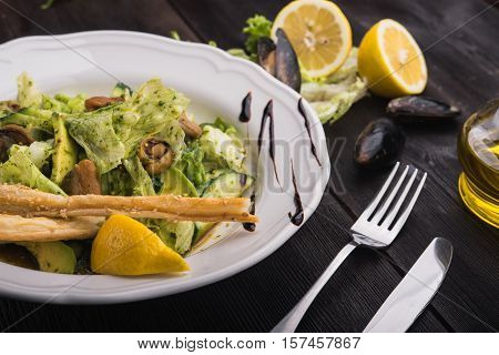 salad with mussels in a restaurant table