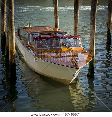 Vintage taxi motorboat moored at Grand Canal in Venice, Italy
