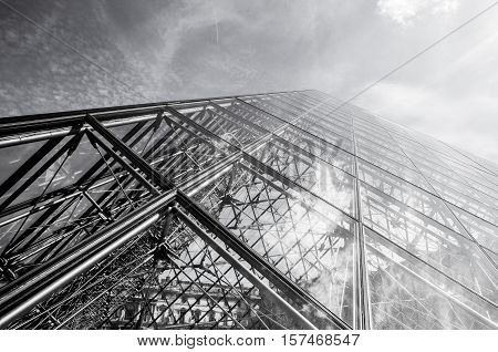 PARIS FRANCE - 02 SEPTEMBER 2015: Building of Louvre in Paris France. The museum is one of the world's largest museums and a historic monument. A central landmark of Paris. Black-white photo.