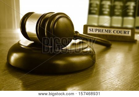 Judge's Supreme Court gavel with law books