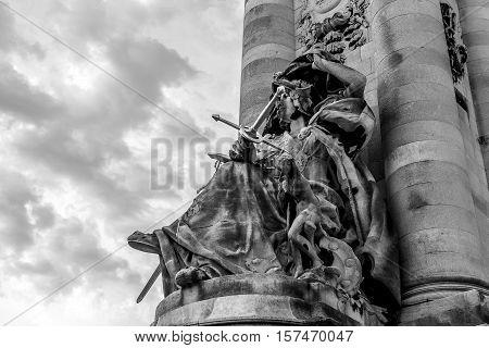 PARIS - FRANCE - AUGUST 30: Black-white photo of sculpture on Alexandre III bridge in Paris on August 30 2015 in Paris.