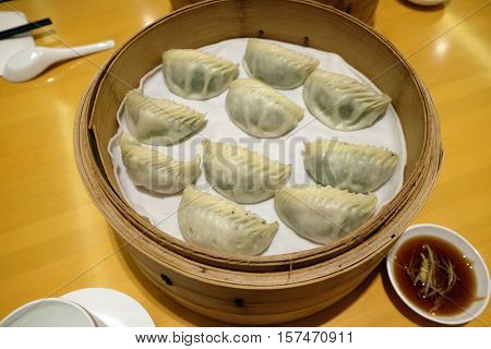 BEIJING - FEBRUARY 23: Chinese steamed dumpling in Bamboo Steamer, commonly eaten in East Asia in Beijing, China, February 23, 2016.