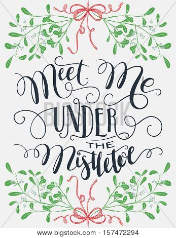 Meet me under the mistletoe. Brush calligraphy isolated on background. Christmas and save the date typography poster