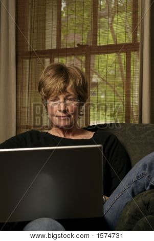 Baby Boomer Works On Laptop