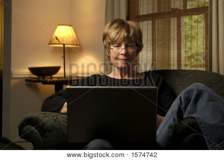 Baby Boom Female Works From Home On Laptop