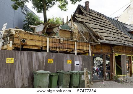 ZAKOPANE POLAND - SEPTEMBER 23 2016: The roof of old wooden building during the renovation or demolition. This building was built at Krupowki street in the end of nineteen century.