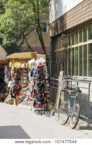 ZAKOPANE POLAND - SEPTEMBER 12 2016: Souvenirs shop in a corner offers regional hats and other souvenirs