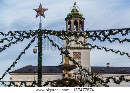 SALBURG AUSTRIA - 11TH DECEMBER 2015: Decorations and the Neue Residenz at Salzburg Christmas Market in the Residenzplatz area during the day