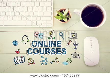 Online Courses concept with workstation on a light green wooden desk