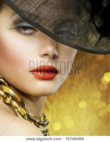 Beautiful Lady over luxury gold background