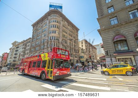 San Francisco, CA, USA - August 17, 2016: Big Bus Hop On Hop Off Sightseeing Tour, the popular double-decker bus carrying tourists ride in the busy streets of Union Square, San Francisco downtown.