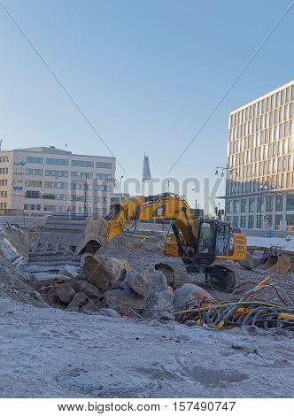 STOCKHOLM SWEDEN - JAN 17 2016: Excavator preparing to build the highest skyscraper (North tower) in Sweden at Hagastaden January 17 2016 in Stockholm Sweden