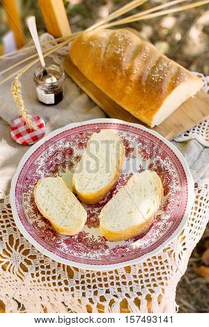 White bread with butter for breakfast in the garden