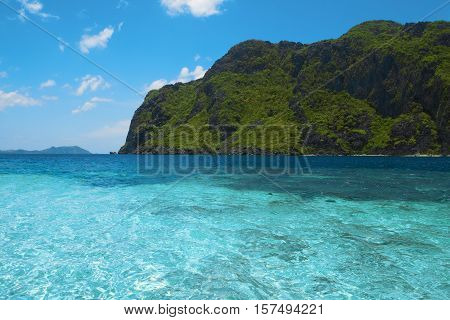 Beautiful tropical sea bay. Scenic landscape with blue lagoon and mountain island El Nido Palawan Philippines Southeast Asia. Exotic scenery. Popular landmark tourist destination of Philippines