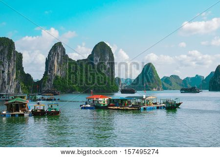 Floating fishing village and rock islands in Halong Bay Vietnam Southeast Asia. UNESCO World Heritage Site. Junk boat cruise to Ha Long Bay. Most popular landmark tourist destination of Vietnam