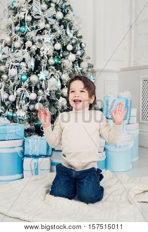 holidays, presents, christmas, x-mas concept - happy child boy with gift box.