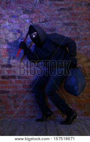 Thief with bag and pickaxe