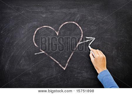 Blackboard heart - love concept. Hand drawing heart with chalk on chalkboard.