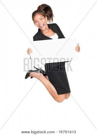 Sign businesswoman jumping happy and excited showing blank empty sign board with copy space for text. Pretty young asian caucasian woman isolated on white background in full length.