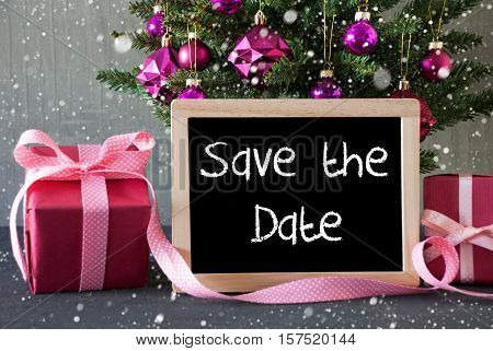 Chalkboard With English Text Save The Date. Christmas Tree With Rose Quartz Balls, Snowflakes. Gifts Or Presents In The Front Of Cement Background.