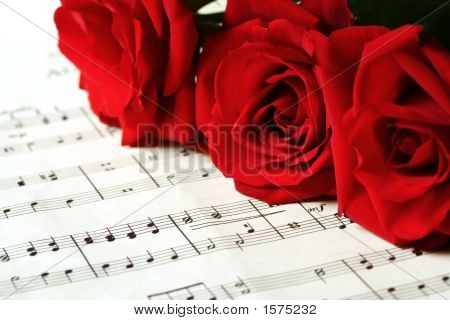 Red Roses On Sheet Music