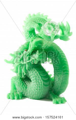 feng shui jade chinese dragon of the lucky charm sculpture isolated on white background