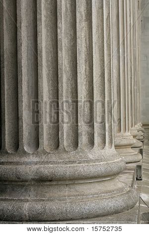 Stone columns from a judicial law building taken during the day