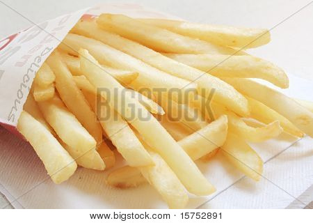 French Fries from a Fastfood Chain on a white table