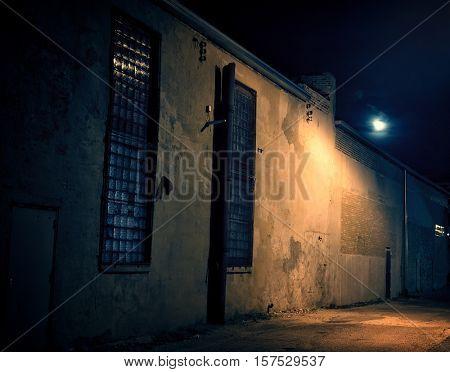 Dark Urban Alley at Night with Moon
