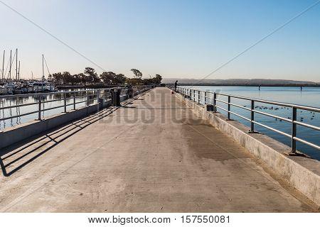 Fishing Pier at the Chula Vista Bayfront Park with marina and San Diego Bay.