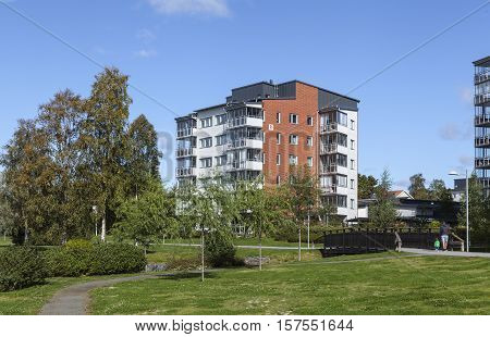 UMEA, SWEDEN ON SEPTEMBER 02. View of a modern residential settlement, park, path, housing on September 02, 2016 in Umea, Sweden. Unidentified persons on the path, footway. Editorial use.