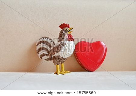 Rooster statue with red heart and copy space. Chineese New Year 2017, Year of rooster.