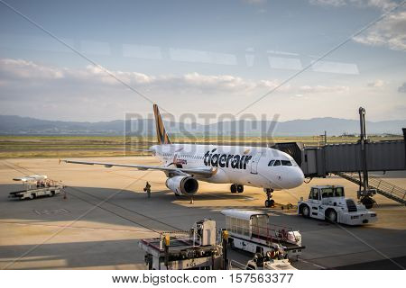 Osaka, Japan - October 2016: Tiger Air aircraft at Kansai International Airport, Osaka, Japan. Tiger Airways Singapore Pte Ltd, operating as Tigerair, is a budget airline headquartered in Singapore.