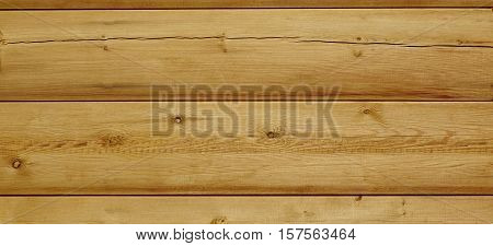 Modern Hewn Natural Log Cabin Or Barn Wall Texture. Rustic Log House Wall Horizontal Timber Background. Unpainted Wooden Debarked Log Rural Building Wall Structure. Abstract Web Banner