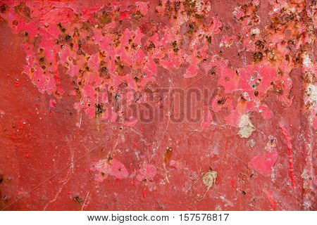 Textured red metal grunge background with cracked distressed paint rust and decay