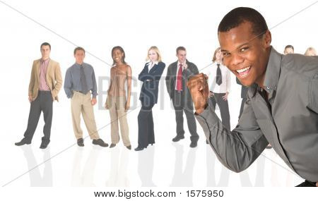 Black African Businessman Standing In Front Of A Business People Group