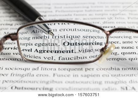 text with the words outsourcing and service level agreement through his glasses
