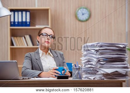 Busy stressful woman secretary under stress in the office
