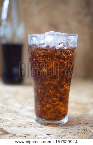 aerated soft drink on wooden backgroundice soft drink on wooden background