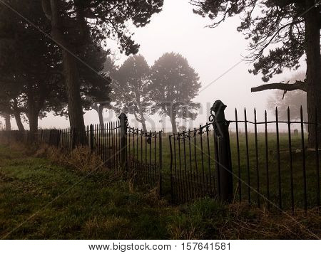 KIRKBY IN ASHFIELD ENGLAND - OCTOBER 31: Old graveyard in the fog England. In Kirkby In Ashfield Nottinghamshire England. On 31st October 2016.