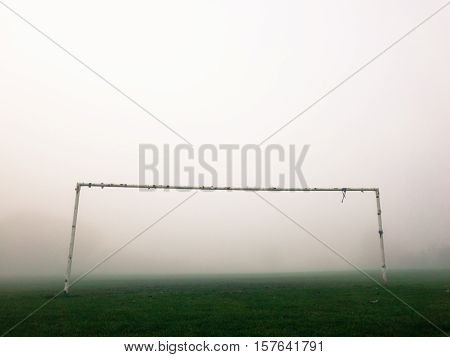 Soccer pitch goal posts in the fog England.